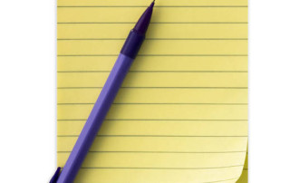 Yellow notepad with a clip and a pencil